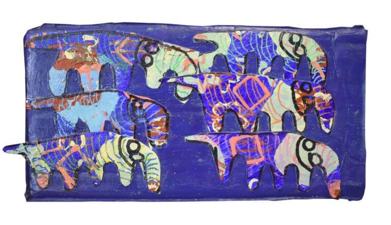 6 painted cut-paper elephants arranged on a purple background