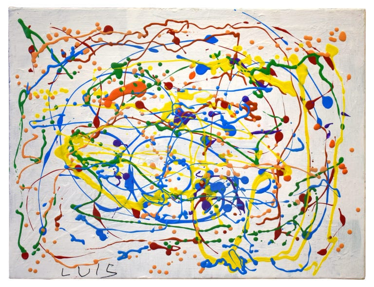 Multi-colored paint splatters on white canvas