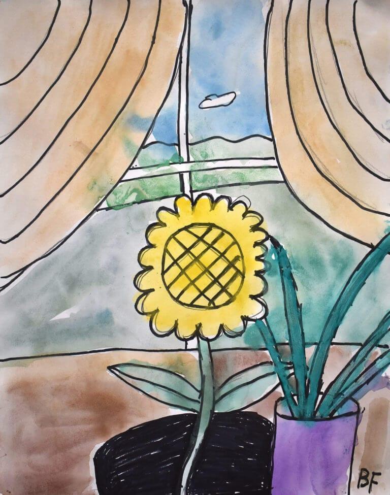 A flower sits in a window sill