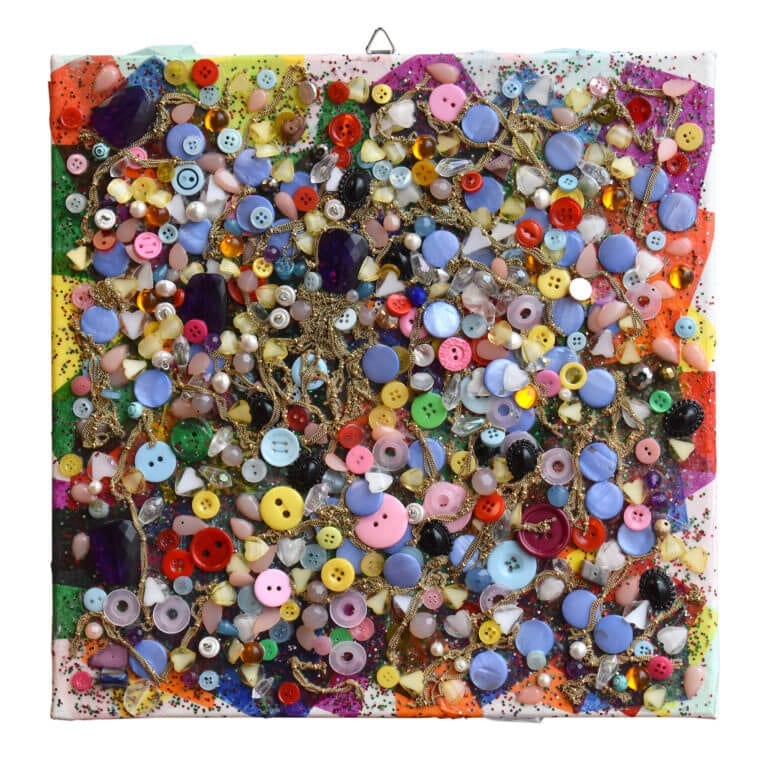 A square mixed media work made from buttons, paper, and glitter