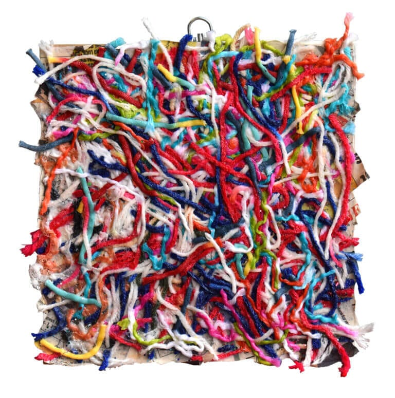 A square-shaped collage made with colorful strings of yarn